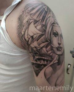 Sailboat and pretty lady tattoo