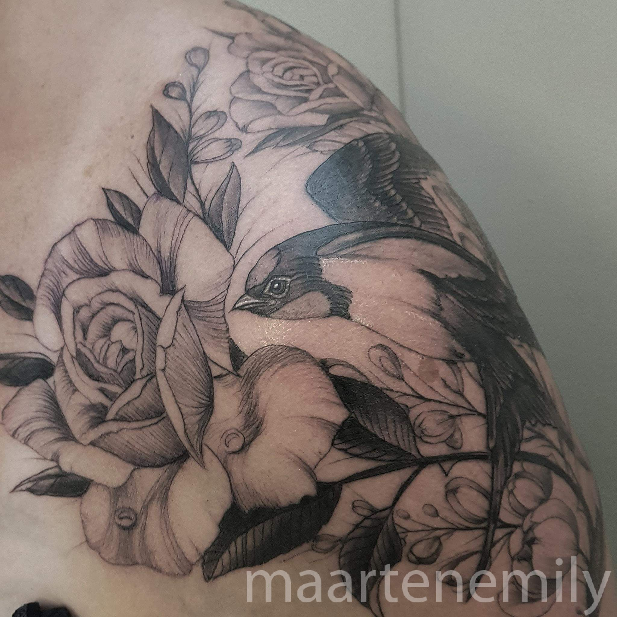 Swallow with flowers tattoo